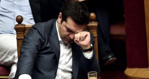 "Greece's prime minister Alexis Tsipras ""has become an enigma: a childlike man, bewildered by a situation he has mistakenly created"". Photograph: Aris Messinis /AFP/Getty Images"