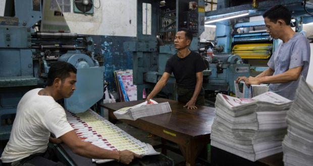 Staff oversee the printing of a Burmese-language newspaper in Rangoon (Yangon).  Photograph: Adam Dean/New York Times