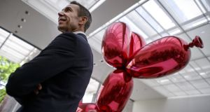 "Jeff Koons with his Balloon Dog (Red): the emblematic, twinkling-eyed face of publishing's New Economy  for Fiona O'Connor – ""I like it, I like it"", the anti-critic's jingling ethos in the celebration of banality. Photograph: Fabrice Coffrini/AFP/GettyImages"