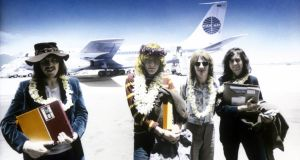 Old school: John Bonham, Robert Plant, John Paul Jones and Jimmy Page arrive at Honolulu Airport, in Hawaii, in 1969, with the master tapes for Led Zeppelin II. Photograph: Robert Knight Archive/Redferns/Getty