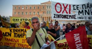 Demonstrators gather outside the Greek parliament during an anti-austerity rally in Athens on Wednesday evening, as MPs voted on a second package of emergency legislation demanded by Greece's creditors. Photograph: Alkis Konstantinidis/Reuters