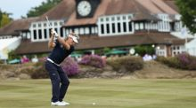 Bernhard Langer plays his second shot on the 18th hole during the first round of the British Senior Open  at Sunningdale Golf Club. Photograph: Andrew Redington/Getty Images