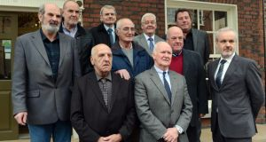 Hooded men: Michael Donnelly, Patrick McNally, Brian Turley, Gerry McKerr, Francie McGuigan, Joe Clarke, Jim Auld, Kevin Hannaway and Liam Shannon with Colm O'Gorman of Amnesty International Ireland, which has acted on their behalf. Photograph: Cyril Byrne
