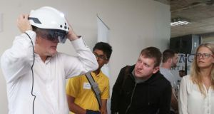 Augmented reality: a Daqri helmet being demonstrated at DCU's 36-hour hackathon