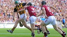 Henry Shefflin of Kilkenny gets by Galway full back Kevin Hynes and centre back Tony Ó Regan during the 2012 All-Ireland Senior Hurling final at Croke Park, which was won by Kilkenny after a replay. Photograph: Morgan Treacy/Inpho.