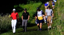 Jason Day  and Luke Donald  lead their group down the 11th hole during round two of the RBC Canadian Ope at Glen Abbey Golf Club in Oakville, Canada. Photograph: Cliff Hawkins/Getty Images