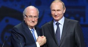 Sepp Blatter stated his trust in Vladimir Putin and Russia over the 2018 World Cup at the draw for the qualifying groups in St Petersburg. Photograph: Afp