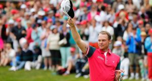 England's Danny Willett salutes the crowd after winning the Omega European Masters  in Crans-Montana, Switzerland. Photograph:  Peter Klaunzer/EPA