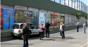 Tourists at the  wall on Cupar Street, off Shankill Road. Photograph: David Sleator