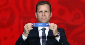 Former German striker Oliver Bierhoff shows the name of Wales during the preliminary draw for the 2018 World Cup qualifiers. Photograph: Getty Images