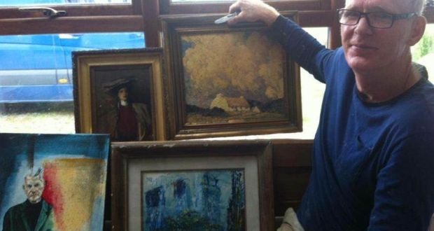 Denis Russell  shows the paintings he found in a hedge near his home in Co Wicklow on Tuesday. Photograph: Whelan family