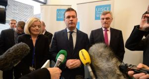 Minister for the Environment  Alan Kelly speaking to the media with John Tierney and Elizabeth Arnett of Irish Water. File photograph: Cyril Byrne/The Irish Times