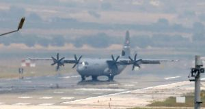 A US Air Force transport plane on the runway at Incirlik Air Base, on the outskirts of the city of Adana, southeastern Turkey on Tuesday. Turkish warplanes started striking militant targets in Syria last week and also allowed the US to launch strikes from Incirlik Air Base. Photograph: AP