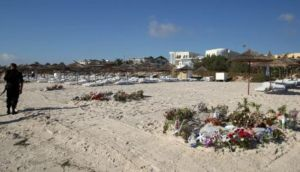 Flowers on the beach near the RIU Imperial Marhaba hotel in Sousse, Tunisia, where 38 people lost their lives after a gunman stormed the beach last month. Photograph: Steve Parsons/PA Wire.