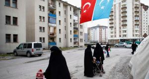 Uighur refugee women   in a gated complex in the central city of Kayseri, Turkey. Photograph: Umit Bektas/Reuters