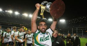 Australia captain Adam Goodes lifts  the Cormac McAnallen Cup at Croke Park in October 2010 after victory over Ireland in the    International Rules Series. Photograph: Cathal Noonan/Inpho