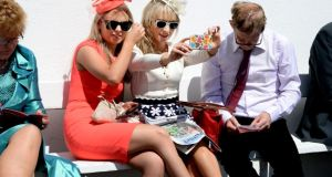 Caroline and Alicia O'Dwyer from Tipperary take a selfie at the Galway races.Photograph: Cyril Byrne/The Irish Times