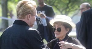 Bono embraces Yoko Ono, widow of Beatles legend John Lennon, at the unveiling of a 24ft x 10ft tapestry depicting the island of Manhattan as a yellow submarine piloted by a waving Lennon at Ellis Island on Wednesday. Photograph: AP