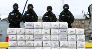 Members of the Irish Naval Service standing behind the drugs seized from the  Makayabella in September. Photograph: PA