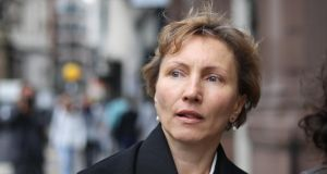 Marina Litvinenko leaving The High Court in London: her husband Alexander, a critic of Russian president Vladimir Putin, was poisoned with a radioactive isotope  in 2006. Photograph: Peter Macdiarmid/Getty Images
