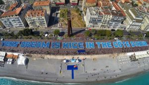 Chinese industrialist Li Jinyuan  brought 6,400 of his employees on holiday to France in May – a trip that cost more than €13million – where they formed a record-breaking 'longest human phrase', reading 'Tiens' dream is Nice in the Côte d'Azur'. Photograph: Valery Hache/AFP/Getty Images