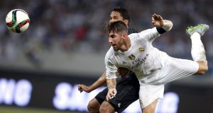 Manchester United target Sergio Ramos in action for Real Madrid against AC Milan in Shanghai yesterday, a match which Real won 10-9 on penalties. Any move by the Spanish club for United goalkeeper David de Gea depends on Ramos going in the opposite direction. Photograph: Aly Song/Reuters