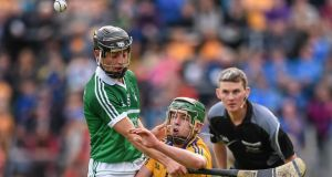 Limerick's Pat Ryan in action against Clare's David Conroy at Cusack Park in Ennis.  Photo:  Stephen McCarthy/Sportsfile