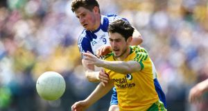 Ryan McHugh of Donegal in action against Monaghan's Darren Hughes during the Ulster SFC Final in Clones. Photograph:  Cathal Noonan/Inpho