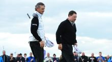 Paul Lawrie of Scotland with fellow Scit Chris Doak (left) on the 18th green after Lawrie lost to Doak on the final hole on the second day of the Paul Lawrie Matchplay at Murcar Links Golf Club in Aberdeen, Scotland. Photograph by Mark Runnacles/Getty Images.