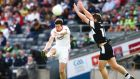 Tyrone's Seán Cavanagh gets his shot away despite the attempted block of Sligo's Brian Curran during the  All-Ireland Round 4B qualifier at Croke Park. Photograph:  Cathal Noonan/Inpho