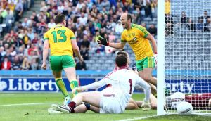Donegal's Patrick McBrearty celebrates scoring the opening goal with Colm McFadden during the  All-Ireland  Round 4B qualifier at Croke Park. Photograph:  Cathal Noonan/Inpho