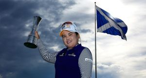 Inbee Park of South Korea poses with the trophy following her victory during the Final Round of the Ricoh Women's British Open at Turnberry Golf Club. Photograph: David Cannon/Getty Images