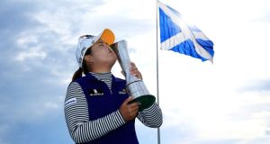 Inbee Park of South Korea kisses the trophy following her victory during the final round of the British Open at Turnberry.  Photo:  David Cannon/Getty Images