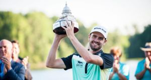 Troy Merritt holds up the trophy on the 18th hole after winning the Quicken Loans National golf tournament at the Robert Trent Jones Golf Club in Gainesville, Virginia. Photo: Pete Marovich/PA