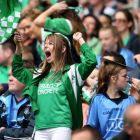 "A Fermanagh fan cheers on her team during Sunday's quarter-final against Dublin in Croke Park. ""They were 10 points down with 15 minutes go to and you would think they were the team winning."" Photograph: James Crombie/Inpho."