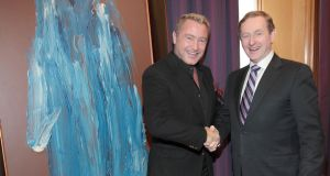 Michael Flatley and  Taoiseach Enda Kenny pose beside one of Flatley's paintings. Photograph: Brian McEvoy.