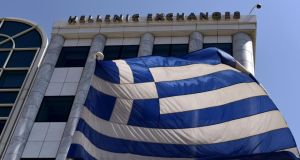 The stock exchange in Athens: National Bank of Greece, a benchmark stock, was down 30 per cent  a few minutes after it reopened. Photograph: Aris Messinis/AFP/Getty Images