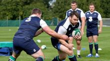 Cian Healy is tackled by  Michael Bent during Ireland training at Carton House on Tuesday. Photograph: Dan Sheridan/Inpho