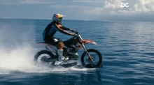 Point bike: stunt rider 'surfs' waves in Tahiti