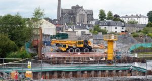 The new Kilkenny bridge and access road  under construction, with St Canice's Cathedral in the background.  Photograph: Eric Luke / The Irish Times