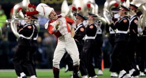 The Ohio State University band performs on the field before the college football playoff national championship game at AT&T Stadium in Arlington, Texas last January. Photo: Jamie Squire/Getty