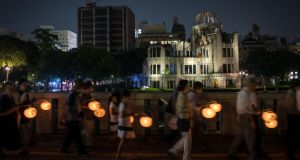 People mark the 70th anniversary of the US attack at the Atomic Bomb Dome at the Hiroshima Peace Memorial Park, Japan. Photograph: Getty Images