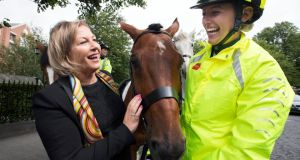 Liz O'Donnell, RSA chairperson, with Melanie Young of the Team Ireland Equestrian U25 eventing squad and her mount Dante, at the RDS for the launch of a booklet from the Road Safety Authority in association with Horse Sport Ireland advising road-users and riders on sharing roads safely. Photograph: Andres Poveda