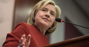 Hillary Clinton: in the running in spite of being a woman. Photograph: Nicholas Kamm/AFP/Getty Images