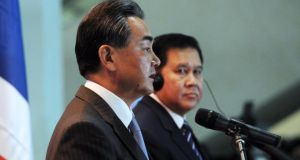 China's foreign minister Wang Yi speaking during a joint press conference with General Tanasak Patimapragorn of Thailand. Photograph: EPA