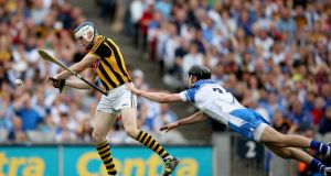 TJ Reid scores Kilkenny's goal despite the attention of Waterford's  Barry Coughlan during the  All-Ireland SHC semi-final at Croke Park. Photograph:  James Crombie/Inpho