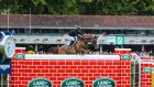 Egypt's Sameh El Dahan on Seapatrick Cruise Cavalier clears the final jump to win the Land Rover Puissance.  Photograph: Gary Carr/INPHO