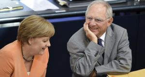 German chancellor Angela Merkel and finance minister Wolfgang Schaüble. Investors have fled instability in the euro zone for the safety of German bonds since 2010, pushing down interest rates on those bonds. Photograph: Odd Andersen/AFP/Getty Images