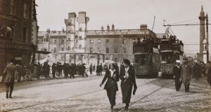 Pedestrians and trams on the street in Dublin on May 18th after the Easter Rising. Photograph: TJ Westropp, courtesy of the Royal Irish Academy.