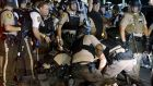Police detain a protester in Ferguson on Monday. Photograph: Rick Wilking/Reuters